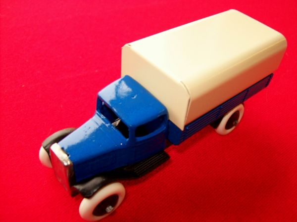 A DINKY TOYS COPY MODEL 25 SERIES TYPE 1 WAGON WITH CREAM TILT AND BLUE BODY